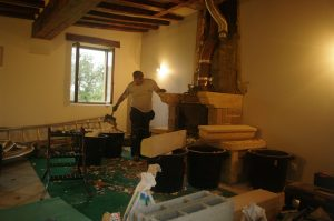The old fireplace being removed